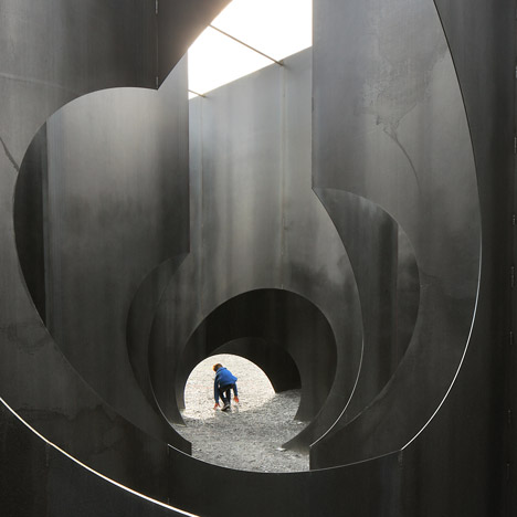 Gijs Van Vaerenbergh's steel maze features spherical, cylindrical and cone-shaped voids