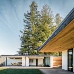 Oak Knoll Residence features cedar and stone cladding to complement its natural setting