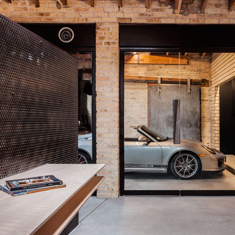 Chicago office by Vladimir Radutny features industrial details and a glass-walled garage