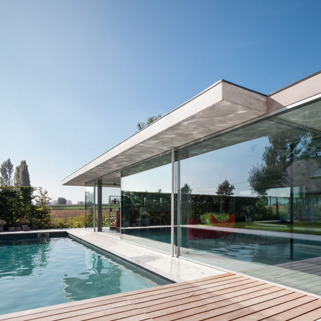 Lieven Dejaeghere's pool house is a glass box topped with a concrete roof