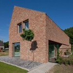 House by Joris Verhoeven features handmade bricks and a lopsided roof