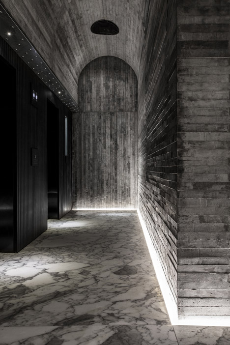 atmospheric photographs of a swedish lake provided the reference material for this hong kong hotel which design systems has lined with flecked marble and
