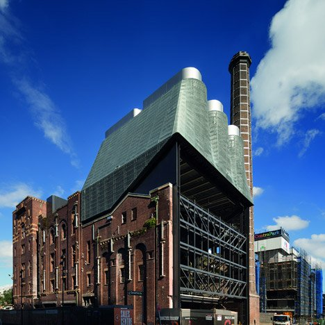Metal-clad power plant by Tzannes Associates is mounted on the roof of an old Sydney brewery