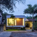 Nha4 Architects adds flood-proof extension to family home in Vietnam