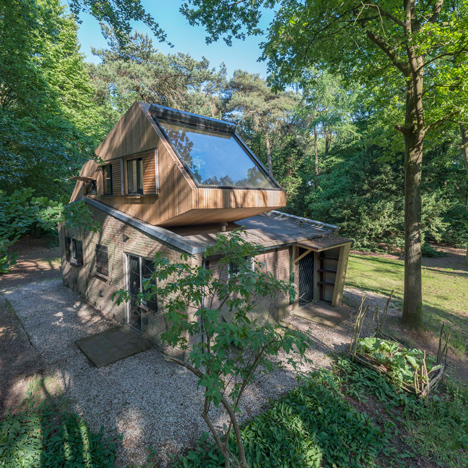 Woodland holiday home updated with rooftop extension facing up to the treetops