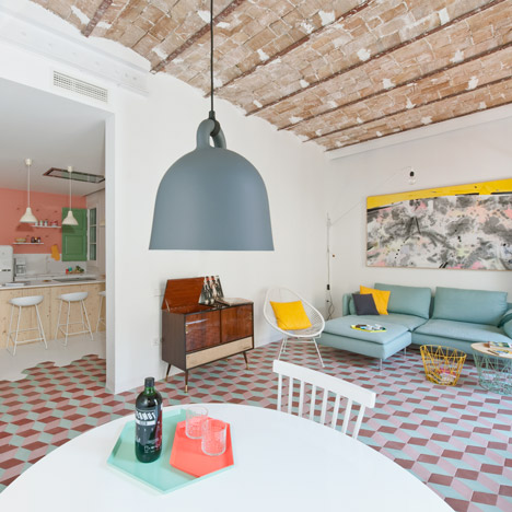 Renovated Barcelona apartment by CaSA features vaulted brick ceilings and colourful floor tiles