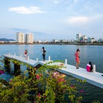 Waterside park by MIA Design Studio runs alongside a lake in Vietnam