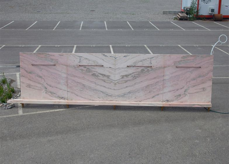 Bureau a installs pink marble urinal at zurich carpark