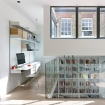 Stiff + Trevillion updates Bloomsbury mews house with gridded glazing and double-height bookcase