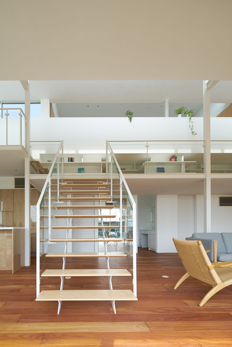 "Open-plan house in Japan by MAMM Design features mezzanine ""street"""