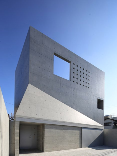 fuse atelier 39 s house in tsudanuma has a perforated facade. Black Bedroom Furniture Sets. Home Design Ideas