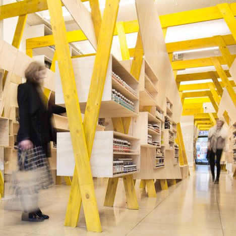 Tandem installs elaborate wooden shelving inside Hugg health and footwear store