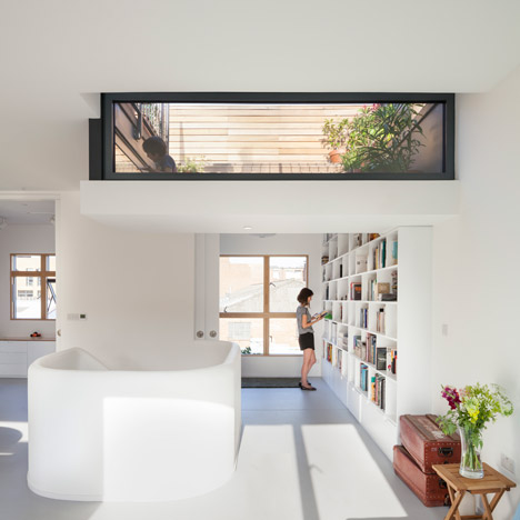 Scenario Architecture lowers a ceiling to create a sunken roof terrace for a London home