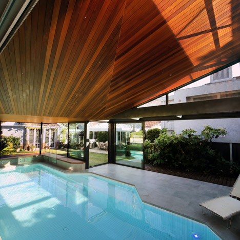 Origami Pool House by Made Group features a faceted timber ceiling
