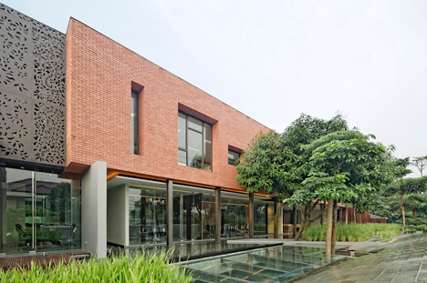 Jakarta office block by Wahana Architects features trailing planting and an underground passage