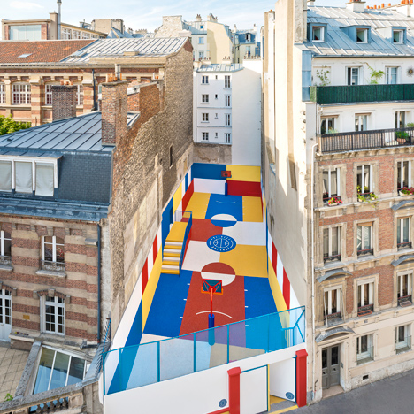Pigalle Duperré is a colourful basketball court tucked between a row of Parisian apartments