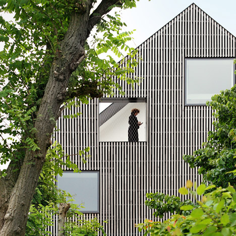 FELT slots three new homes into an old Ghent townhouse and reclads it with strips of wood