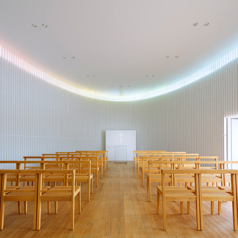 Rainbow hues are cast onto the walls of Kubo Tshushima's Tokyo wedding chapel