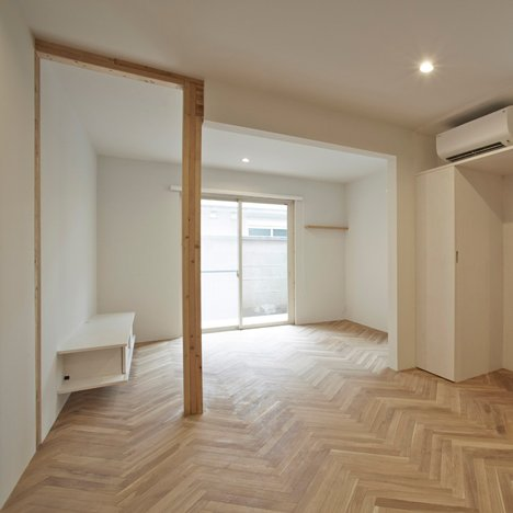 Saito House in Tokyo features herringbone flooring and an exposed wooden structure