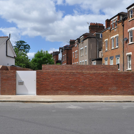 Jack Woolley's Spiral House is hidden behind a simple brick wall