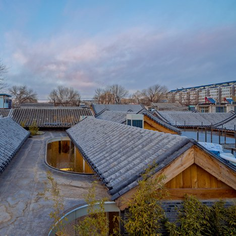 Arch Studio transforms Beijing hutong into tea house with curving glass courtyards