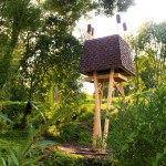 "The Wild Thing is a ""creature-like"" cabin that stands tall above a Latvian wildflower meadow"