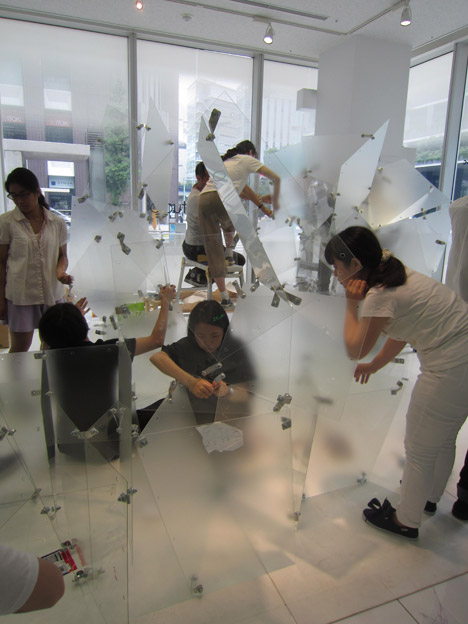Students assembling Transparent Structures installation
