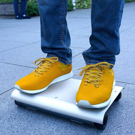 Cocoa Motors' WalkCar transports passengers on a laptop-sized board