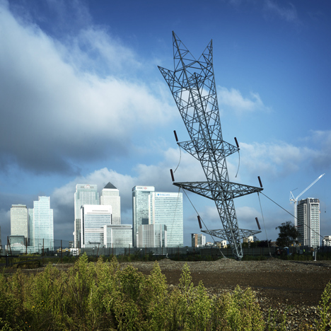 Alex Chinneck unveils installation modelled on upside-down electricity pylon