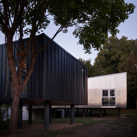 Graal Architecture adds trio of corrugated metal cabins to a kindergarten in France