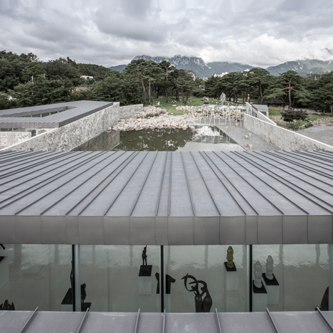 Craggy concrete walls surround South Korean sculpture park by Archium