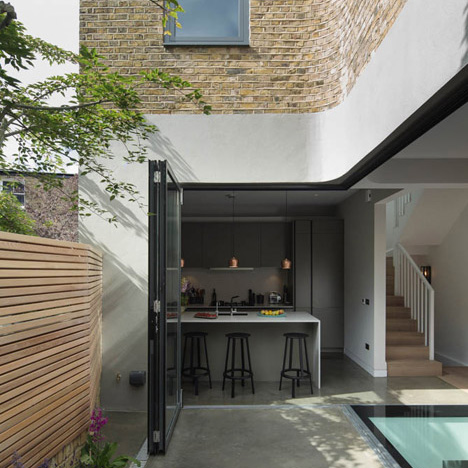 Brackenbury House by Neil Dusheiko features a curved brick extension and pop-up cinema room