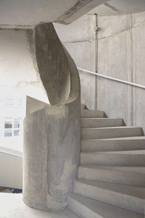 Concrete apartment building in Zellweger Park by Herzog and de Meuron