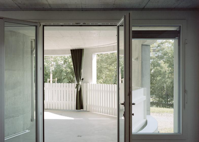 Concrete apartment building in Zellweger Park by Herzog and de Meuron