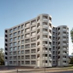 Staircase towers form corners of Uster apartment building by Herzog & de Meuron