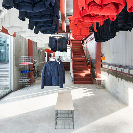 Clothes descend from the ceiling at Schemata Architects' Descente Blanc Tokyo store