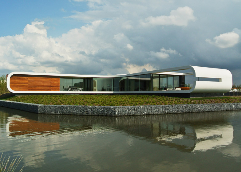 Corian facade wraps around waterside home in the Netherlands