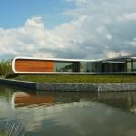Corian facade wraps around waterside home in the Netherlands