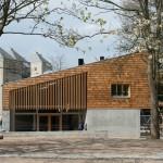 Shingled community centres by Sophus Søbye Arkitekter face into Copenhagen parkland