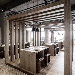 Slatted timber boxes contain dining areas inside Fanbo Zeng's Fun noodle bar