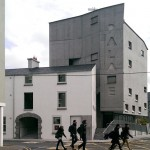 Cast-concrete Galway Picture Palace by dePaor Architects stands behind a Georgian terrace