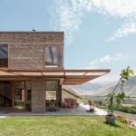 Rafael Freyre uses natural and local materials to connect House in Azpitia with its setting