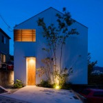House in Ikoma has a central void that stretches all the way up to its pitched roof