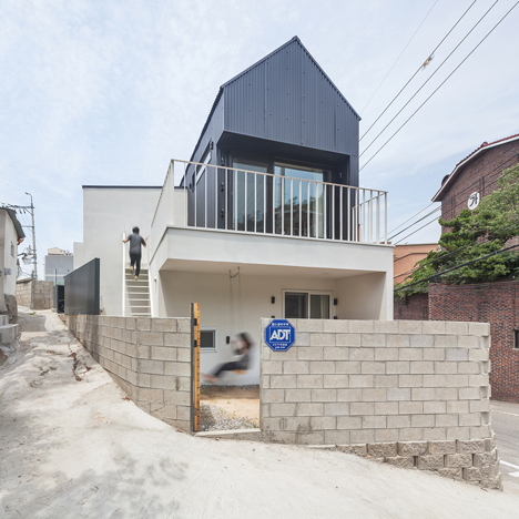 House in Seoul by OBBA features a retractable staircase and a loft for cats