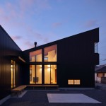 Junichi Kato clads House in Shigaraki in dark brown-coated steel