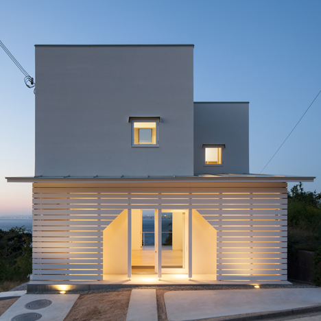 House on Awaji Island has a timber porch with a house-shaped entrance