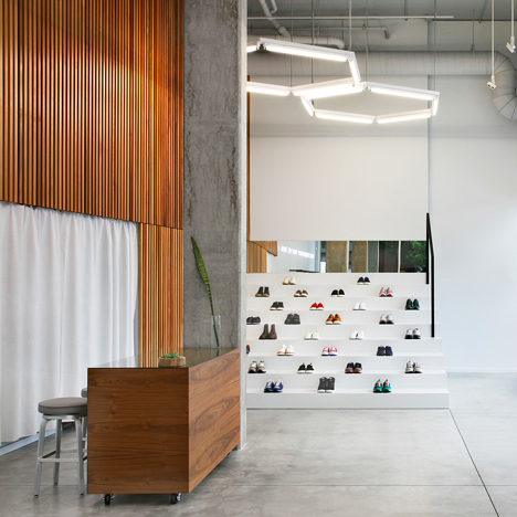 Sneakers are displayed on bleachers in Seattle boutique by Best Practice Architecture