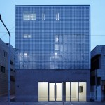 Perforated metal panels reveal a staircase in Smart Architecture's Lotus Haus
