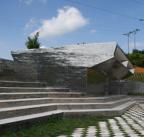 Rural Urban Framework uses mirrored tiles to camouflage toilets at Mulan Primary School