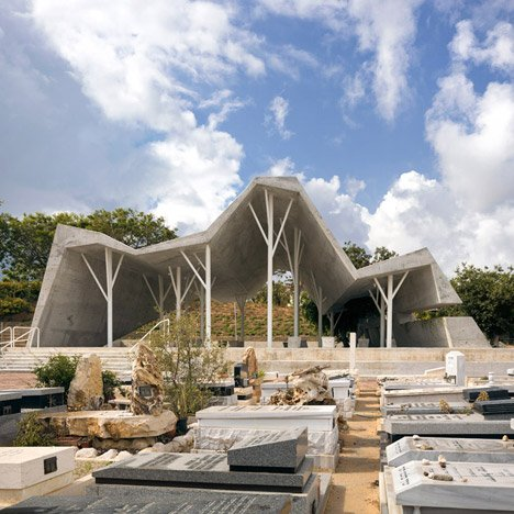 Jagged concrete canopy by Ron Shenkin shelters mourners at a cemetery in Israel
